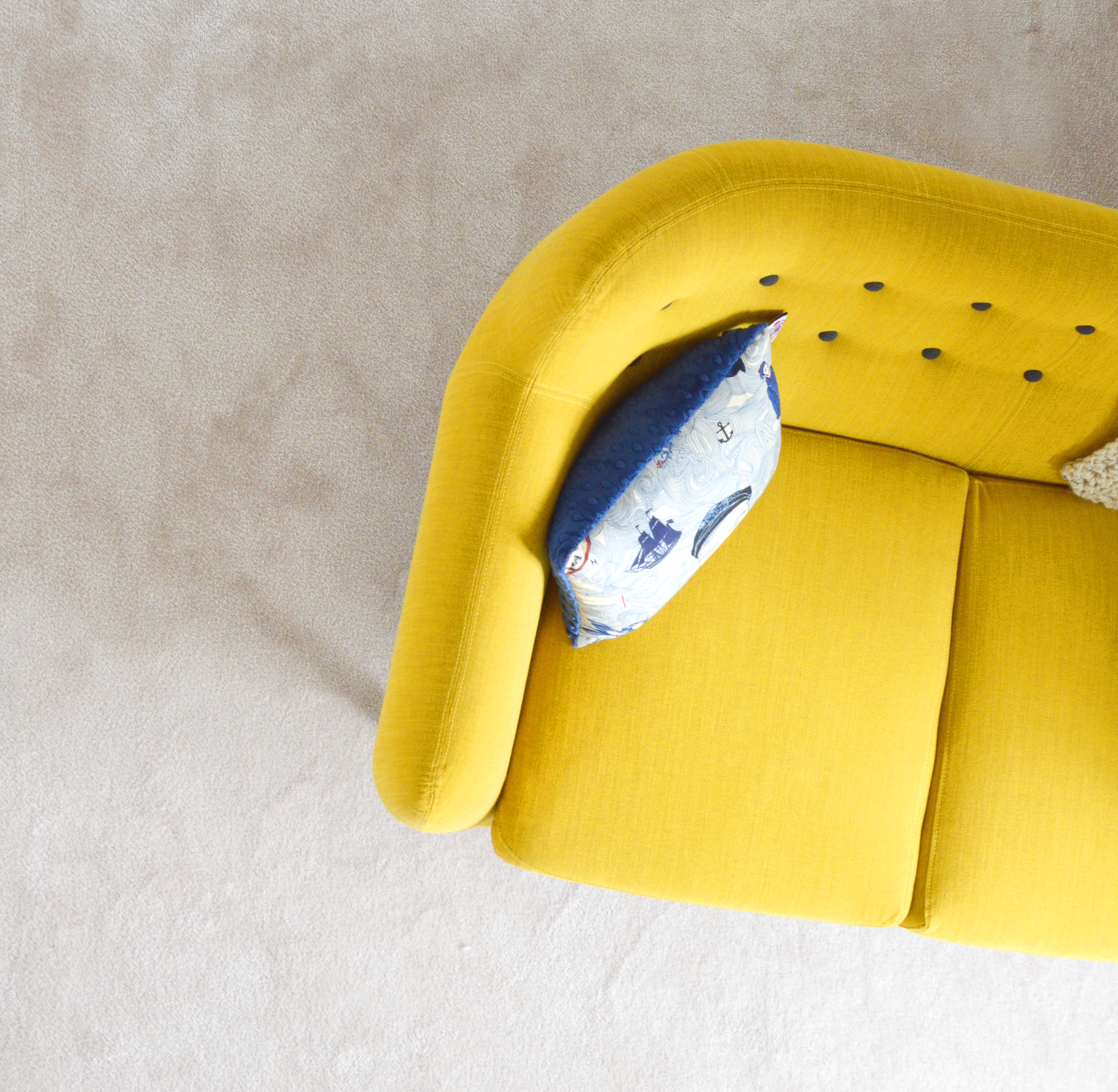 Add in a bold statement piece of furniture in one of the trending colours